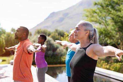 people doing yoga in mountain retreat setting